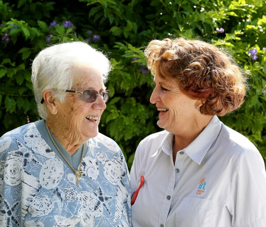 An elderly lady at home with her live-in carer