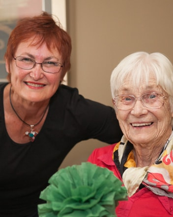 Two women smiling in an IRT community