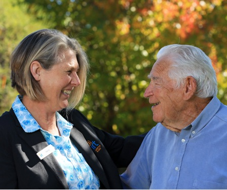 IRT community lifestyle manager smiling with an elderly man