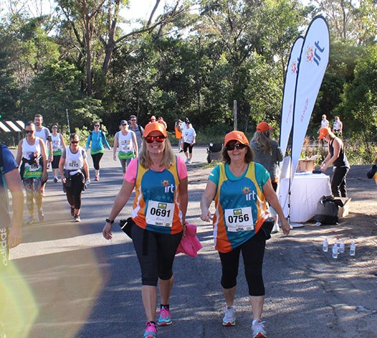 Two IRT staff members walking during the Mountain to Mountain challenge in Wollongong