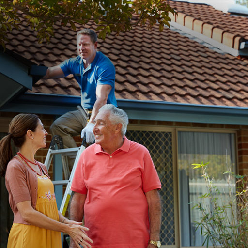 A maintenance contractor assisting elderly man and daughter with work - Retirement Living Council Campaign