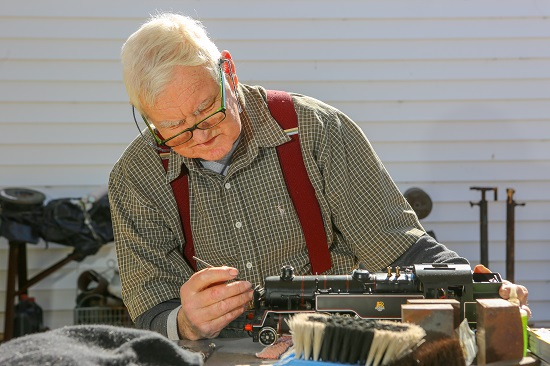 IRT Home Care customer Barry Glover tinkers with his miniature trains.