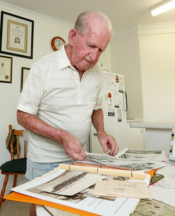 older male resident looking at photos