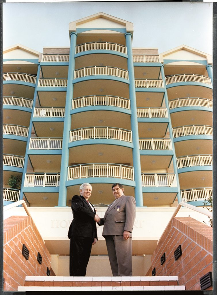 Noel Howard (right) and Charles Young, Former CEO of ECH (an aged care service provider in South Australia) standing in front of Howard Court.