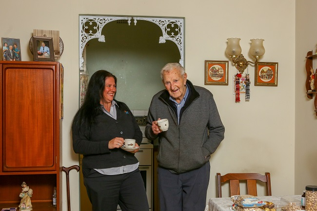 Home Care employee Tracey Kelly and customer Stan Neale enjoy each other's company.