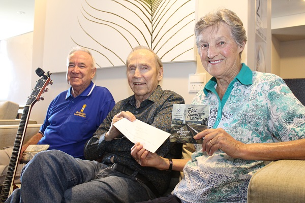 Dave and Doreen Bryars presenting a cheque to Graham, which was part of the proceeds of the CD donations.
