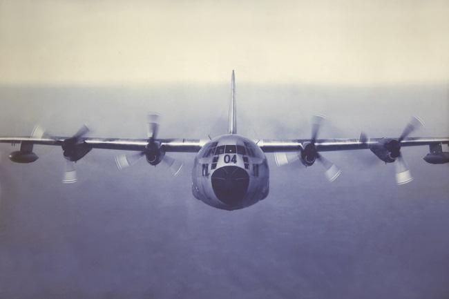Dick Marman flying a C-130 – a heavy transport plane.