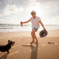 Lady with dog doing balance exercsises
