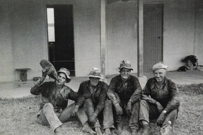 Ray (far left) with a group of Finnish mates having a well-earned break from working on the cane fields in Ingham, North Queensland.