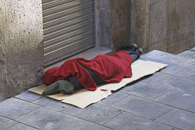 Homeless person sleeping on street