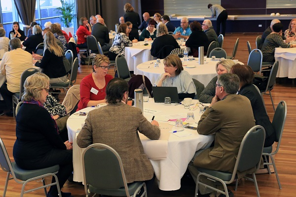 People sitting at roundtable dicussing mature workfroce