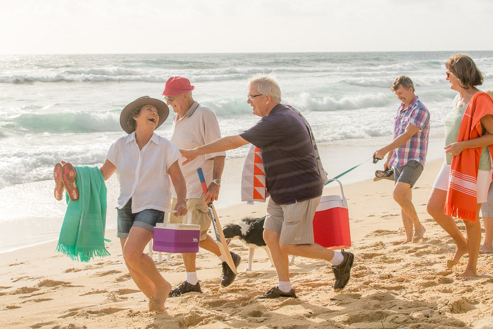 Retirees laughing on the beach
